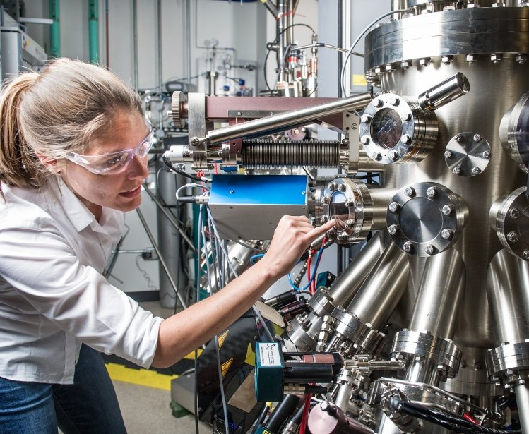 NREL scientist uses a Compound Semiconductor Molecular Beam Epitaxy System