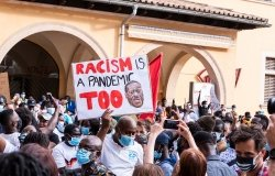 Palma de Mallorca, Spain - June 07 2020: Man surrounded by crowd holding a banner